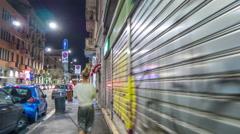 Night illumination milan city shopping street walk panorama 4k time lapse italy Stock Footage