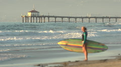 Portrait of a woman stand-up paddleboard surfing at the beach with the Manhattan Stock Footage