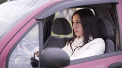 Sad woman driver in car Stock Footage