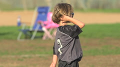 Boys ages 6 to 8 playing in a youth soccer league game, slow motion. Stock Footage