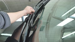 Mechanic putting on a new wiper blade on a customers truck Stock Footage