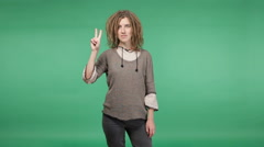 Beautiful hipster woman with dreadlocks showing peace Stock Footage