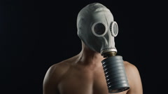 Close up portrait of a naked man in a gas mask Stock Footage