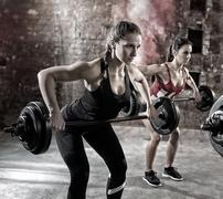 Young bodybuilders have training. Stock Photos
