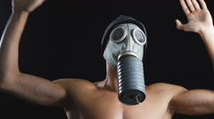 Naked man dance with a gas mask covering his face. Good clip for party Stock Footage