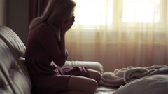 Depressed woman in bed. girl crying on the couch. acute mountain Stock Footage