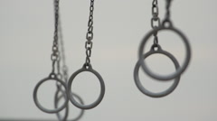 The Santa Monica traveling rings swinging freely in the air. Stock Footage