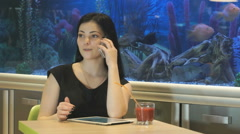 Brunette woman talking on a cellphone indoors Stock Footage
