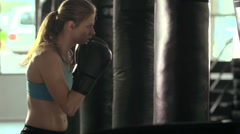 Woman does Muay Thai kickboxing training at the gym, slow motion. Stock Footage