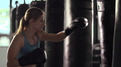 Woman does Muay Thai kickboxing training at the gym, super slow motion. Stock Footage