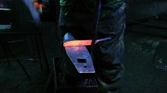 Blacksmith Forging a Knife Stock Footage
