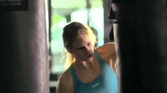 Woman doing Muay Thai kickboxing training at the gym, slow motion. Stock Footage