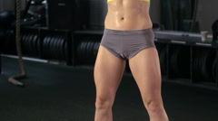 A woman stretching at the gym, slow motion. Stock Footage