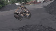 Outdoor Grab Bucket Weighs and Swings Over a Pile of Coal Stock Footage