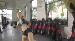 POV of a woman doing Muay Thai kickboxing training at the gym. Stock Footage