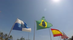 Brazil flag waving in the wind on the beach in Rio de Janeiro, Brazil Stock Footage