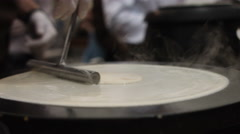 Hand With Special Tools Cooking Pancakes on the Plate.. the Action in Real Time Stock Footage