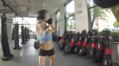 POV of a woman doing Muay Thai kickboxing training at the gym, slow motion. Stock Footage