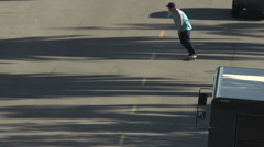 A young man skateboarding in the middle of the street, slow motion. Stock Footage