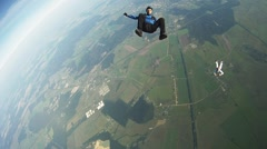 Professional skydivers freestyle in sky. Adrenaline. Free falling. Flight Stock Footage