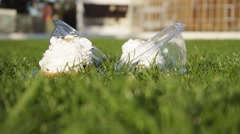 Sweet white cakes on the grass in park Stock Footage