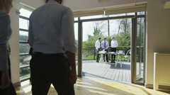 4K Business team in a meeting, office with outdoor area set in natural landscape Stock Footage