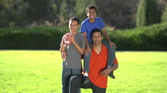 Group portrait of a father and his sons with a football , slow motion. Stock Footage