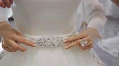 Fitting wedding dress, sew a dress, shop asssistant help customer Stock Footage