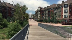 A view from a Platte River pedestrian bridge that crosses over river in Denver, Stock Footage