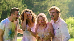 Excited group of friends soaking wet at Holi festival, summer holiday, happiness Stock Footage
