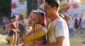 Happy young couple in love dancing and hugging at Holi festival, tenderness HD Footage