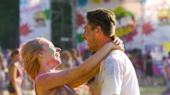 Sweet couple hugging and dancing, enjoying weekend at Holi festival, love Stock Footage