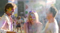 Girl throwing colorful powder above head, best friends dancing at Holi festival HD Footage