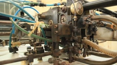The machine is operating in the printing workshop Stock Footage