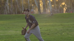 A young man playing catch with a baseball, super slow motion. Stock Footage