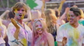 Best friends enjoying concert, dancing like crazy at Holi festival, happy crowd HD Footage