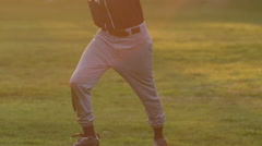 A young man playing catch with a baseball, slow motion. Stock Footage