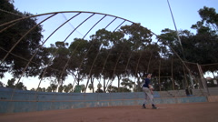 A baseball player practicing his swing , slow motion. Stock Footage