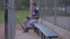 A baseball player resting on the bench , slow motion. Stock Footage