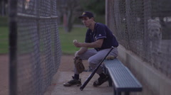 A baseball player resting on the bench , super slow motion. Stock Footage