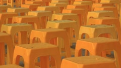 Scene yellow plastic chairs were ranked above ground Stock Footage