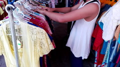 Girls choose the clothes in the store Stock Footage