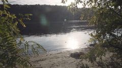 Riverside at sunset on river Dniepr Stock Footage