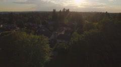 Breathtaking Sunset Aerial of Suburban Neighborhooods with Golden Hour Stock Footage