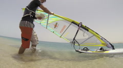 A man windsurfing on the Red Sea in Egypt, slow motion. Stock Footage