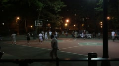 NEW YORK CITY : Night NX shot of Athletes play urban street Stock Footage