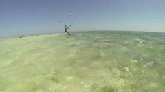 A woman kite surfing on the Red Sea in Egypt. Stock Footage