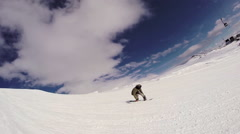 Men snowboarding down a mountain, slow motion. Stock Footage