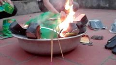 Burning clothes, paper money for the dead, Asian Stock Footage