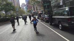 NEW YORK CITY: The Broadway Bomb is longboarding skateboarding Stock Footage